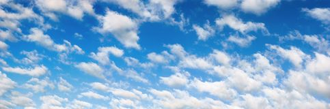 Fluffy white clouds on blue sky panorama Stock Photo