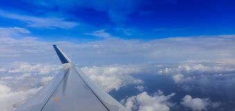 White clouds on a blue sky from a plane window background. Space for text. Fluffy white clouds on a blue sky from a plane window background. Space for text Stock Photo