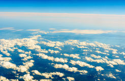Fluffy white clouds and blue sky seen from airplane. Stock Photography