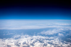 Fluffy white clouds and blue sky. Stratosphere. View from above.  Stock Photos
