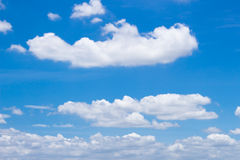 Fluffy white clouds and bright blue sky. Ease in holiday Royalty Free Stock Photo