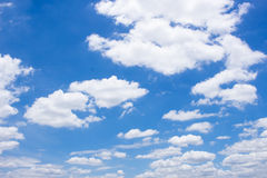 Fluffy white clouds and bright blue sky. Ease in holiday Stock Photos