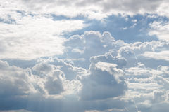 Fluffy white clouds and bright blue sky. Ease in holiday Stock Photography