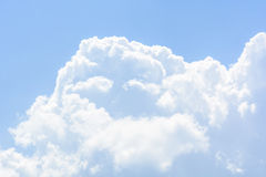 Fluffy white clouds in the sky Stock Photo