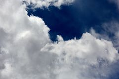 Fluffy white cumulus cloud formations stock images