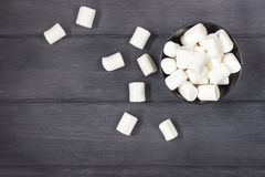 Free Fluffy White Marshmallow In Round Bowl On  Black Wooden Table Wi Stock Photography - 96943392