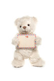Fluffy white teddy bear with a card Stock Photography