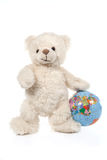 Fluffy white teddy bear with a globe Stock Photography