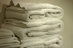 Fluffy White Towels. A stack of Fluffy white bath towels royalty free stock image