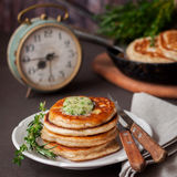 Fluffy Wholemeal Pancakes with Herbed Butter Royalty Free Stock Photos