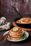 Fluffy Wholemeal Pancakes with Herbed Butter Royalty Free Stock Image