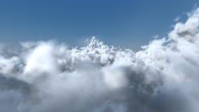Flug durch die weißen Wolken Stockbild