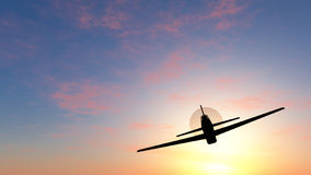 Flug in einem Sonnenuntergang Lizenzfreies Stockfoto