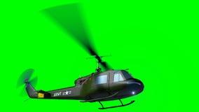 Fluga för helikopter UH-1 på den gröna skärmen lager videofilmer