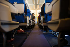 Fluggäste innerhalb der Kabine Stockfotografie