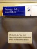 Fluglinie-Sitztaschen-Info Stockfotos
