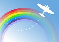 Flugzeug über dem Regenbogen Lizenzfreie Stockfotografie