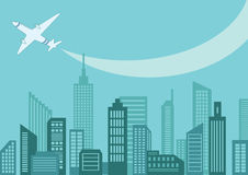 Flugzeug über der Stadt Stockfotos