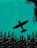 Flugzeug über Stadthintergrund   Stockfotografie