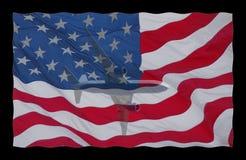 Flugzeug auf amerikanischer Flagge stockbilder