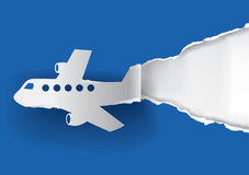 Flugzeug, das Papier zerreißt Stockfotografie