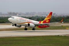 Flugzeug Hainan Airliness Boeing 737-700 Lizenzfreie Stockfotografie