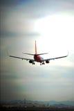 Flugzeug-Landung am Himmel-Hafen-Flughafen Lizenzfreie Stockbilder