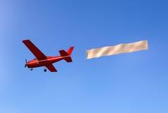 Flugzeug mit einer Meldung lizenzfreie abbildung