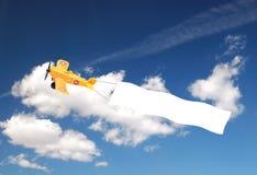 Flugzeug mit Fahne Stockfotos