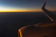 Flugzeug am Sonnenuntergang Lizenzfreies Stockfoto