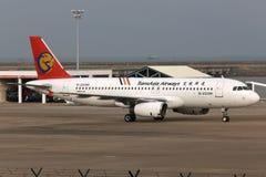 Flugzeug TransAsia Airwayss Airbus A320 Lizenzfreie Stockfotos