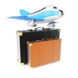 Flugzeug und Koffer Stockfoto