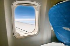 Flugzeugfenster Stockbild