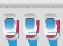Flugzeugkabine mit Öffnungen und Sitzen Stockbild