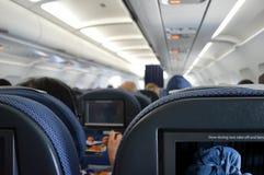 Flugzeugkabinen-Innenraumpassagiere Stockfoto