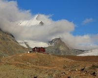Fluhalp and snow capped Strahlhorn royalty free stock photography