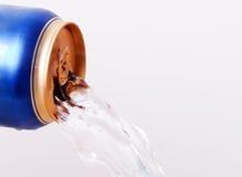 Fluid flows from aluminum cans Stock Photos