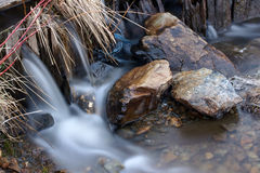 Fluidity on the stone royalty free stock photography
