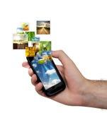 Fluindo o telefone móvel Fotografia de Stock Royalty Free