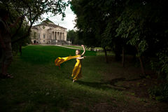 Fluing girl near renesance villa Royalty Free Stock Photo