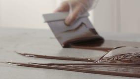Flujo derretido del chocolate