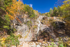 Flume Cascade, Crawford Notch State Park. Beautiful fall foliage at the Flume Cascade. Crawford Notch State Park, White Mountains, New Hampshire Stock Images