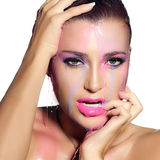 Fluor Makeup Explosion. Colorful Beauty and Fashion under flowin. Sensual woman face under flowing water. Make-up molten fluor. Beauty and Fashion closeup Stock Photography