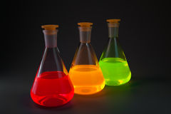 Fluorescence in flasks diagonally Stock Image