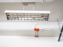 Fluorescence lamp installed on ceiling. Showing tube line on the beam Royalty Free Stock Image