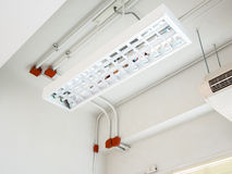 Fluorescence lamp installed on ceiling. Showing tube line and ventilating system Stock Photography