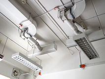 Fluorescence lamp installed on ceiling. Showing tube line and ventilating system Royalty Free Stock Images