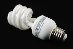 Fluorescent bulb with black background Stock Image