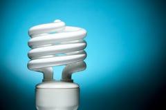 Fluorescent Bulb on Blue Background Stock Image