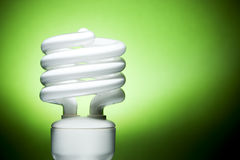 Fluorescent Bulb on Green Background Royalty Free Stock Photography